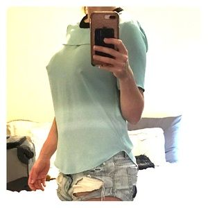 BCBG blue top with back cut out